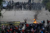 День революции египтяне встретили массовыми беспорядками