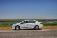 По родным дорогам, темным и убогим: идем на рекорд Гиннесса с Peugeot 408