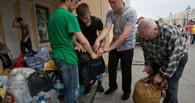 Омичи отправили в Амурскую область вагон одежды и стройматериалов