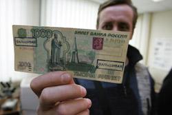 В Омске бизнесмен рассчитался на кассе гипермаркета поддельной «тысячей»
