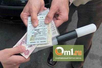 Уволенный омский полицейский распечатал поддельные права на домашнем принтере