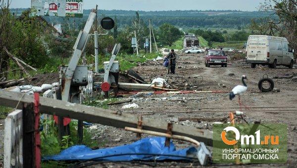 Ополченцы оставили еще один город в Донецкой области, бои продолжаются