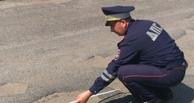 Омская полиция измерила глубину ям на Красноярском тракте